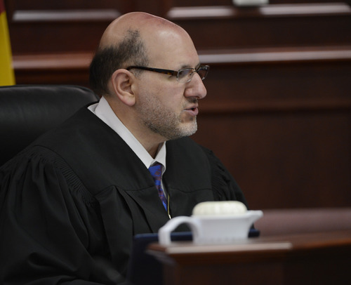 Judge Carlos A. Samour Jr. speaks during a hearing for Aurora theater shooting suspect James Holmes in Centennial, Colo., on Tuesday, June 4, 2013. Samour accepted  plea of not guilty by reason of insanity from Holmes.  He also ruled that prosecutors can have access to a notebook Holmes sent to a psychiatrist before last summer's rampage. (AP Photo/The Denver Post, Andy Cross, Pool)
