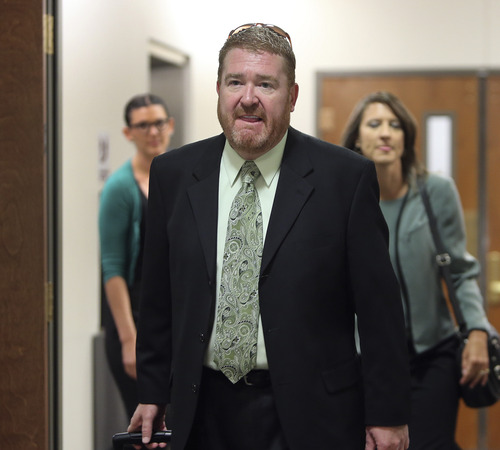 Defense attorney Daniel King arrives at district court for a hearing for Aurora theater shooting suspect James Holmes in Centennial, Colo., on Tuesday, June 4, 2013. Holmes is charged with killing 12 people and wounding more than 50 in a crowded Colorado movie theater last year.  Holmes could enter his long-expected insanity plea at the hearing Tuesday, though the case could also veer off on another tangent as his lawyers seek the strongest possible defense. Judge Carlos Samour Jr. has indicated he will allow James Holmes to change his plea from not guilty to not guilty by reason of insanity. (AP Photo/Ed Andrieski)