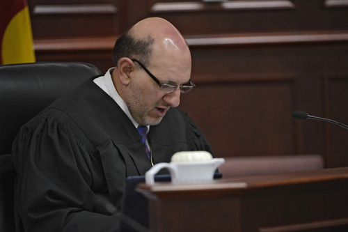 Judge Carlos A. Samour Jr. reads an advisement during a hearing for Aurora theater shooting suspect James Holmes in Centennial, Colo., on Tuesday, June 4, 2013.   Judge Samour ruled prosecutors can have access to a notebook   Holmes sent to a psychiatrist before last summer's rampage.  (AP Photo/The Denver Post, Andy Cross, Pool)