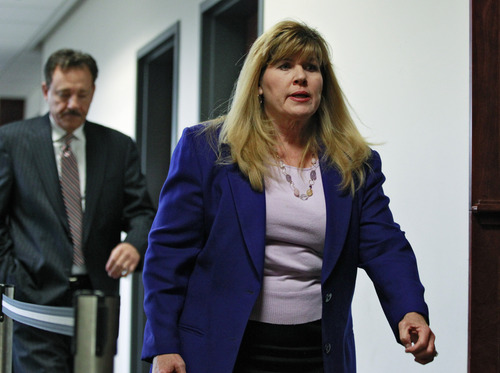 Assistant District Attorney Karen Pearson leaves district court after a hearing for Aurora theater shooting suspect James Holmes in Centennial, Colo., on Tuesday, June 4, 2013. Holmes was allowed to enter a plea of not guilty by reason of insanity. (AP Photo/Brennan Linsley)