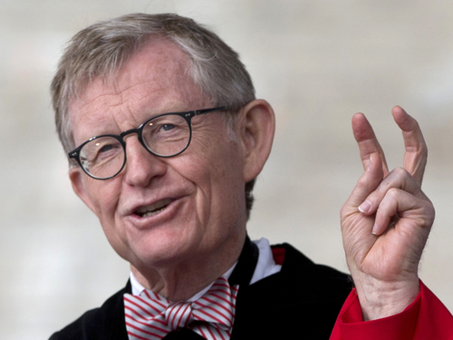 """In this Sunday, May 5, 2013 photo, Ohio State president E. Gordon Gee speaks during the Ohio State University spring commencement in Columbus, Ohio. Gee told a university committee last December that Notre Dame wasn't invited to join the Big Ten because they're not good partners while also jokingly saying that """"those damn Catholics"""" can't be trusted. (AP Photo/Carolyn Kaster)"""