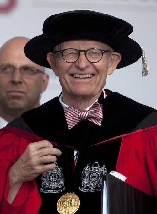 """This photo made Sunday, May 5, 2013, shows Ohio State president E. Gordon Gee during the Ohio State University spring commencement in Columbus, Ohio. Gee told a university committee last December that Notre Dame wasn't invited to join the Big Ten because they're not good partners while also jokingly saying that """"those damn Catholics"""" can't be trusted. (AP Photo/Carolyn Kaster)"""