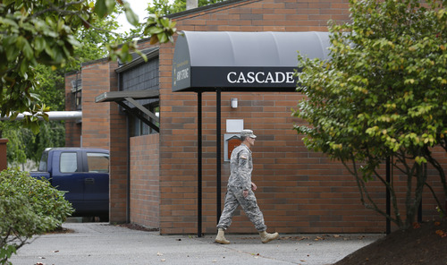 A solider walks Wednesday, June 5, 2013, outside the building housing the military courtroom where U.S. Army Staff Sgt. Robert Bales was taking part in a plea hearing at Joint Base Lewis-McChord in Washington state. Bales is accused of 16 counts of premeditated murder and six counts of attempted murder for a pre-dawn attack on two villages in Kandahar Province in Afghanistan in March, 2012. (AP Photo/Ted S. Warren)