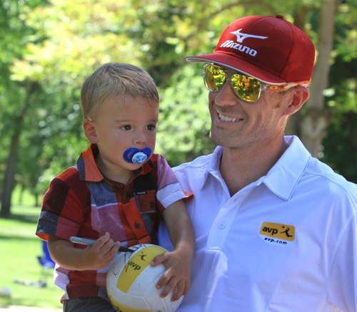 Rick Egan  | The Salt Lake Tribune   Utah native and two-time Olympian Jake Gibb holds his 1-year-old son, Crosby, at Liberty Park, Wednesday, June 5, 2013. Gibb is promoting the AVP Pro Beach Volleyball Tour coming to Utah in August.