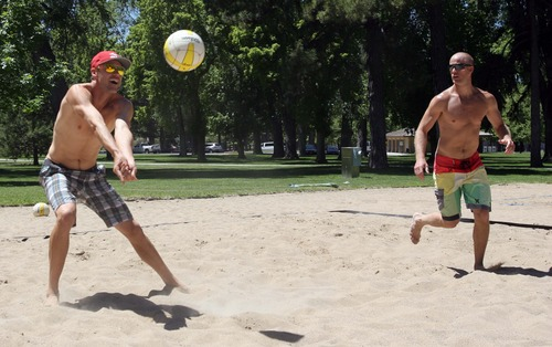 Rick Egan  | The Salt Lake Tribune   Jake Gibb (left) plays volleyball along with Derran Cannon (right) at Liberty Park, Wednesday, June 5, 2013. Gibb is promoting the AVP Pro Beach Volleyball Tour coming to Utah in August.