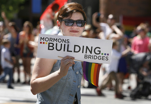 Scott Sommerdorf   |  The Salt Lake Tribune Part of the Mormons Building Bridges group as they parade in the Utah Pride Festival's Gay Pride Parade through the streets of downtown Salt Lake City, Sunday, June 2, 2013.