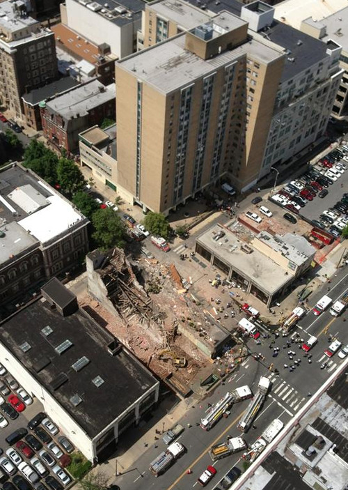 This photo provided by Russell Krause shows  the scene of a building collapse on the edge of downtown Philadelphia on Wednesday June 5, 2013. The four-story building being demolished collapsed, injuring 12 people and trapping two others, the fire commissioner said. Rescue crews were trying to extricate the two people who were trapped, city Fire Commissioner Lloyd Ayers said. The dozen people who were injured were taken to hospitals with minor injuries, he said.(AP Photo/Russell Krause)