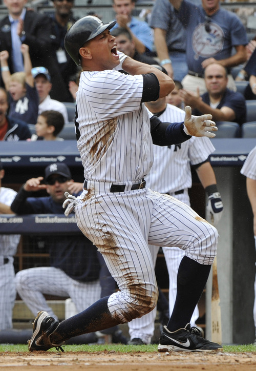 New York Yankees' Alex Rodriguez reacts after scoring on a single by Robinson Cano during the first inning of a baseball game against the Oakland Athletics Saturday, Sept. 22, 2012, at Yankee Stadium in New York. (AP Photo/Bill Kostroun)