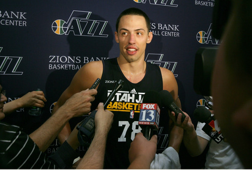 Rick Egan  | The Salt Lake Tribune   University of Utah center, Jason Washburn, talks to the media after his pre-draft workout with the Utah Jazz, Thursday, June 6, 2013.