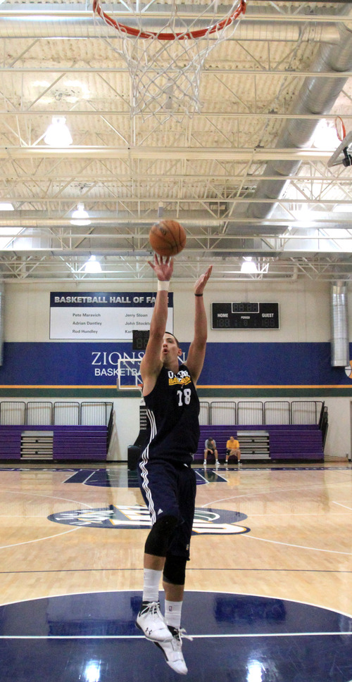 Rick Egan  | The Salt Lake Tribune   University of Utah center, Jason Washburn, takes some shots during his pre-draft workout with the Utah Jazz, Thursday, June 6, 2013.