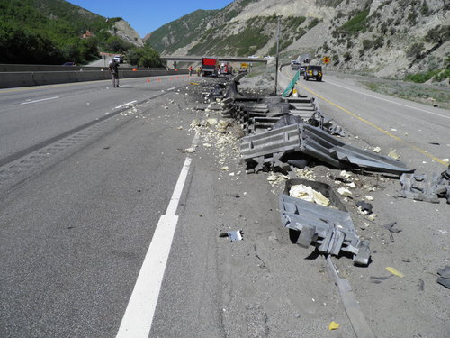 Wreckage from a semi rig's collision with an I-80 guardrail Thursday. (UHP photo)