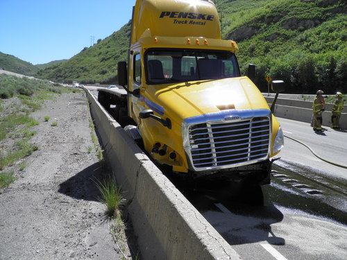 The driver of this semi rig sustained minor injuries in an I-80 crash Thursday. Hazmat crews also had to clean up spilled fuel from the crash. (UHP photo)