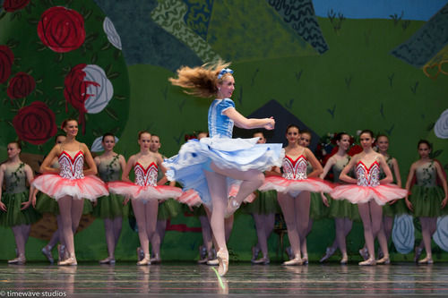 """Courtesy of Timewave Studios Lindsay Longmore performs the title role in the Bountiful School of Ballet's performance of """"Alice in Wonderland"""" last month. The ballet studio celebrated their 40th year in business this year."""