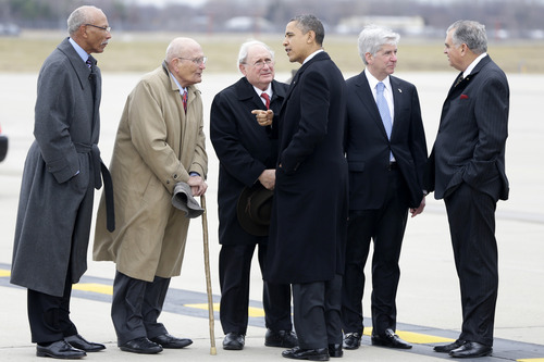 FILE- In this Dec. 10, 2012 file photo, President Barack Obama and Transportation Secretary Ray LaHood, right, are met by, from left: Detroit Mayor Dave Bing; Rep. John Dingell, D-Mich.; Sen. Carl Levin, D-Mich., and Michigan Gov. Rick Snyder, after stepping off Air Force One upon his arrival at  Metropolitan Wayne County Airport in Detroit. Fifty seven years ago, Rep.  Dingell, who this week becomes the longest serving member of Congress in history, nearly began his career in tears on the floor of the House. Members were delivering tributes to his father, John Dingell Sr., who had died recently. (AP Photo/Charles DharapakFile)