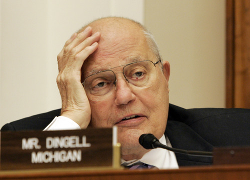 FILE - In this Nov. 13, 2007 file photo, House Energy and Commerce Committee Chairman Rep. John Dingell, D-Mich., asks question of a witness during a committee's hearing on food safety, on Capitol Hill in Washington. Fifty seven years ago, Rep.  Dingell, who this week becomes the longest serving member of Congress in history, nearly began his career in tears on the floor of the House. Members were delivering tributes to his father, John Dingell Sr., who had died recently. (AP Photos/Susan Walsh, File)