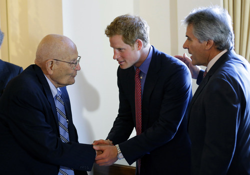 FILE- In this May 9, 2013 file photo, Rep. John Dingell, D-Mich., left, speaks with England's Prince Harry, and British Ambassador Sir Peter Westmacott, before a reception and dinner at the British Ambassador's residence, in Washington. Fifty seven years ago, Rep.  Dingell, who this week becomes the longest serving member of Congress in history, nearly began his career in tears on the floor of the House. Members were delivering tributes to his father, John Dingell Sr., who had died recently. (AP Photo/Alex Brandon, Pool, FILE)
