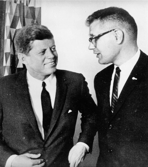 FILE- This undated file photo provided by Rep. John Dingell's office, shows the congressman with President John F. Kennedy. Fifty seven years ago, Rep. John Dingell, who this week becomes the longest serving member of Congress in history, nearly began his career in tears on the floor of the House. Members were delivering tributes to his father, John Dingell Sr., who had died recently.(AP Photo/Courtesy of the Dingell Family, File)