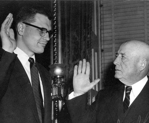 FILE- This 1955 file photo provided by Rep. John Dingell's office, shows the congressman being sworn in by mentor and Speaker of the House Sam Rayburn of Texas in 1955. Fifty seven years ago, Rep. John Dingell, who this week becomes the longest serving member of Congress in history, nearly began his career in tears on the floor of the House. Members were delivering tributes to his father, John Dingell Sr., who had died recently. (AP Photo/Courtesy of the Dingell Family, File)