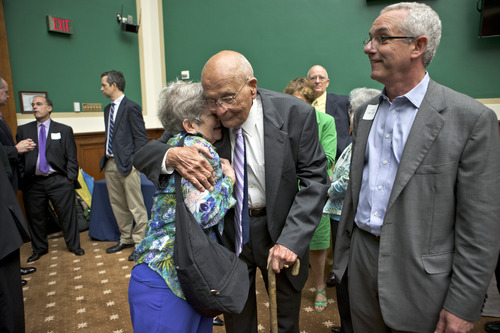 """Rep. John Dingell, D-Mich., embraces Leanor Lewis, a former chief of staff, as he is celebrated by friends and colleagues on Capitol Hill in Washington, Friday, June 7, 2013, upon becoming the longest-serving member of Congress in history with his 20,997th day as a representative. A former chairman of the Energy and Commerce Committee, Dingell, now 86, says he has no plans to retire as the representative of Michigan's 12th District that inclueds Dearborn and Ypsilanti. Rep. Dingell recalled wisdom passed on by his late father, Congressman John D. Dingell Sr., """"It's not how long you serve; it's how well you serve."""" (AP Photo/J. Scott Applewhite)"""