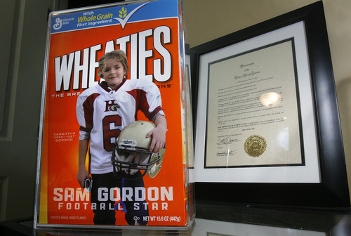 "Scott Sommerdorf   |  The Salt Lake Tribune Sam Gordon on a Wheaties box is displayed in her room alongside a proclamation from South Jordan declaring that December 18th, 2012 was ""Sam Gordon Day."" Gordon, who's now 10, became famous as a girl playing football against boys. The story blew up, to where she attended the Super Bowl as the NFL commissioner's guest, to cite just one example."