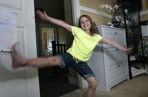 "Scott Sommerdorf   |  The Salt Lake Tribune Sam Gordon demonstrates her ""Sam Dance"" in her room, Wednesday, May 15, 2013."