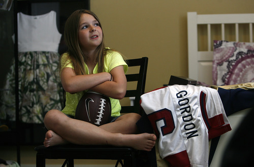 Scott Sommerdorf   |  The Salt Lake Tribune Sam Gordon contemplates a question about her future in her room, Wednesday, May 15, 2013. Gordon, who's now 10, became famous as a girl playing football against boys.