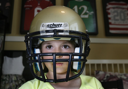 Scott Sommerdorf   |  The Salt Lake Tribune Sam Gordon wears her Herriman football helmet in her room, Wednesday, May 15, 2013. Gordon, who's now 10, became famous as a girl playing football against boys. The story blew up, to where she attended the Super Bowl as the NFL commissioner's guest.