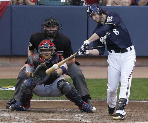 Milwaukee Brewers' Ryan Braun hits a two RBI double during the fifth inning of Game 1 of baseball's National League championship series against the St. Louis Cardinals Sunday, Oct. 9, 2011, in Milwaukee. (AP Photo/Jeff Roberson)