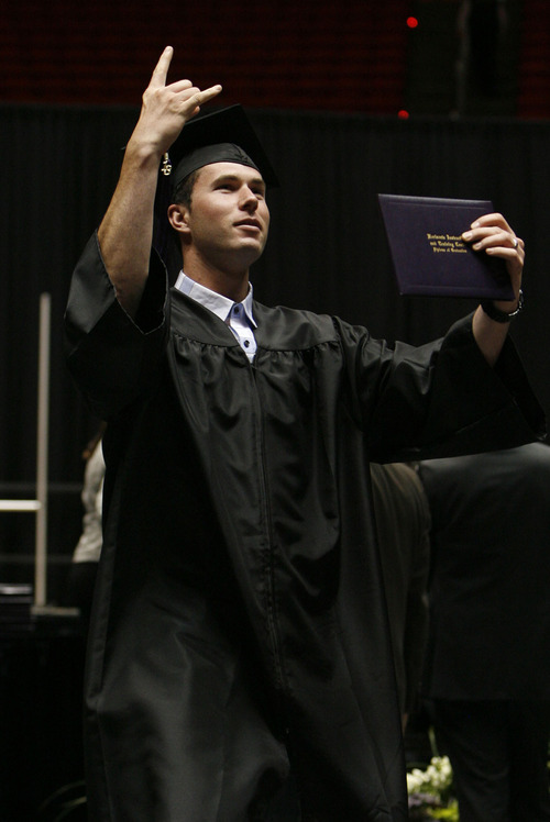 Francisco Kjolseth  |  The Salt Lake Tribune Horizonte High's Anthony Beckstead celebrates receiving his diploma during graduation ceremonies at the Huntsman Center on the University of Utah campus on Wednesday, June 5, 2013.