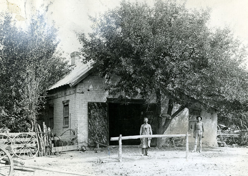Tribune file photo  Sidney P. Teeples, left, and Carl Anderson stand outside the first blacksmith shop in Millard County. The shop was in Holden. The date is unknown.