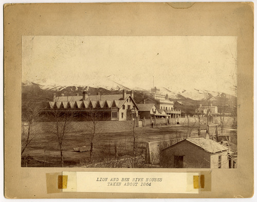 Tribune file photo  The Lion House, left, and Beehive House between State Street and Main on South Temple circa 1864.