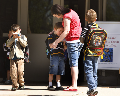 Leah Hogsten     The Salt Lake Tribune Jennifer Ericksen picks up her son Miles from his kindergarten class, Friday May 10, 2013. Ericksen is among some 25,000 people who may lose their limited health care benefits provided through the state's PCN program if Utah fails to expand Medicaid and the U.S. government fails to renew the program. Ericksen has Type I Diabetes and a host of other health problems and could die within about 36 hours if she fails to get her insulin - a drug provided to her through the PCN program.
