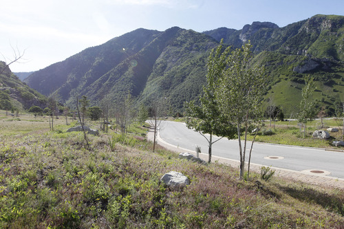 Al Hartmann  |  The Salt Lake Tribune The Salt Lake County Planning Commission took a driving tour of the proposed Tavaci Development site at the mouth of Big Cottonwood Canyon Friday June 7. Although much of the infrastructure has been in place for years, most of the housing lots have remained unsold. Developer Terry Diehl is asking the county to rezone 47 acres for a high-density project after disconnecting from Cottonwood Heights, which did not go along with his request.
