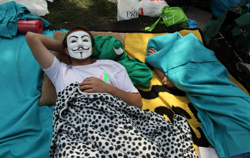 Protesters sleep in Kugulu Park in Ankara, Turkey, Saturday, June 8, 2013. A senior European Union official, the EU enlargement commissioner Stefan Fule on Friday, criticized Turkish police's harsh crackdown on protesters in the last week, asked that abusers be investigated and punished and told an audience that included Turkish prime minister Recep Tayyip Erdogan, that as a EU-candidate country, Turkey should aspire to the highest standards of democracy.(AP Photo/Burhan Ozbilici)