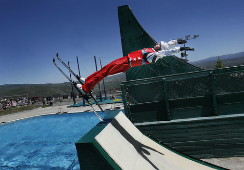 Scott Sommerdorf   |  The Salt Lake Tribune The moment of take-off as Kiley McKinnon, of The Flying Ace All-Star Freestyle jumpers opens their summer season of shows at the Utah Olympic Park, Sunday, June 9, 2013.