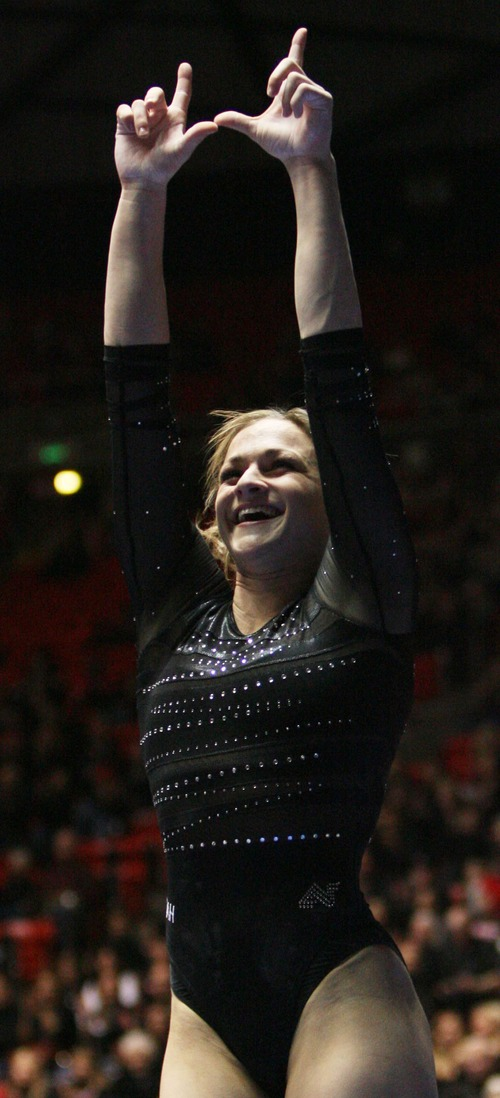 Kim Raff  |  The Salt Lake Tribune University of Utah gymnast Lia Del Priore flashes the University of Utah sign after competing in the vault event during a meet against Stanford at the Huntsman Center in Salt Lake City on February 23, 2013.