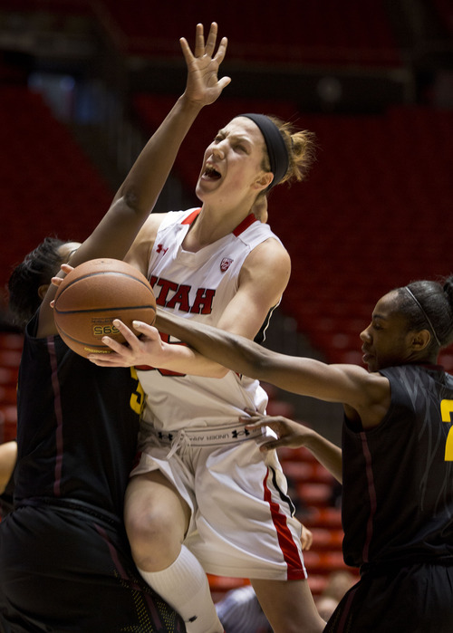 Lennie Mahler  |  The Salt Lake Tribune Michelle Plouffe draws a foul in the first half of a game at the Huntsman Center on Sunday, Jan. 20, 2013. The Utes defeated the Sun Devils 66-46.