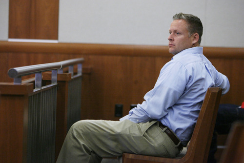 Francisco Kjolseth  |  The Salt Lake Tribune Brandon Babcock, left, appears in 3rd District Court in West Jordan for a pretrial conference on Monday, June 10, 2013. The Utah chiropractor is accused of bilking the elderly through a scheme to cure their diabetes.