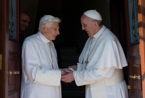RETRANSMISSION OF OSS101 TO PROVIDE DIFFERENT CROP -- In this photo provided by the Vatican newspaper L'Osservatore Romano, Pope Emeritus Benedict XVI, left, is welcomed by Pope Francis as he returns at the Vatican from the pontifical summer residence of Castel Gandolfo on Thursday, May 2, 2013. (AP Photo/Osservatore Romano, HO)