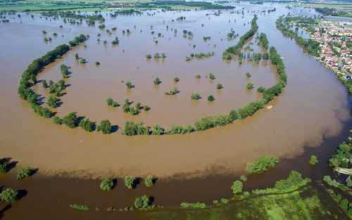 Aerial view of the river Elbe tha has flooded fields next to the city of Elster, eastern Germany, June 5, 2013. Heavy rainfalls cause flooding along rivers and lakes in Germany, Austria, Switzerland, the Czech Republic and Hungary. (AP Photo/dpa, Patrick Pleul)