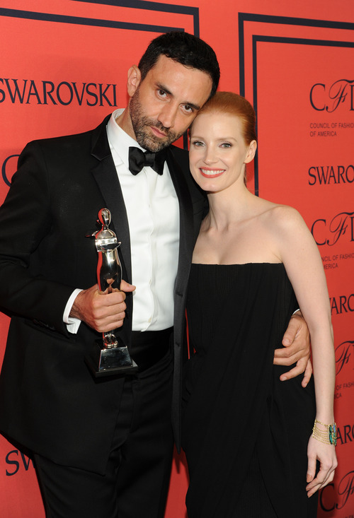 International Award honoree Riccardo Tisci, left, and actress Jessica Chastain pose in the press room at the 2013 CFDA Fashion Awards at Alice Tully Hall on Monday, June 3, 2013 in New York. (Photo by Evan Agostini/Invision/AP)