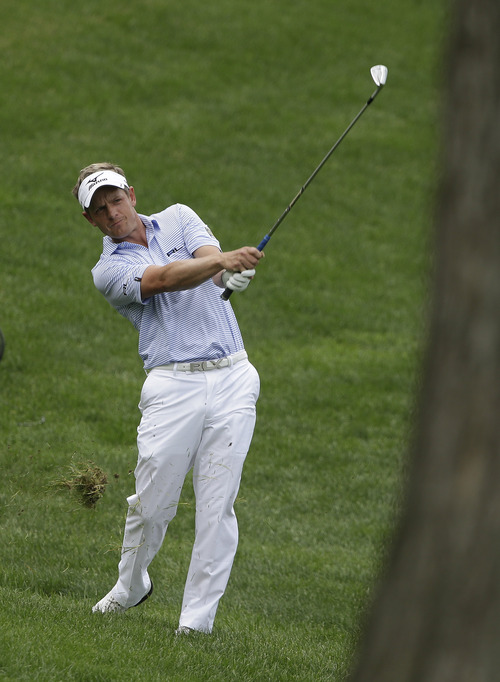 Luke Donald, of England, hits to the 14th green during the second round of the Memorial golf tournament Friday, May 31, 2013, in Dublin, Ohio. (AP Photo/Darron Cummings)