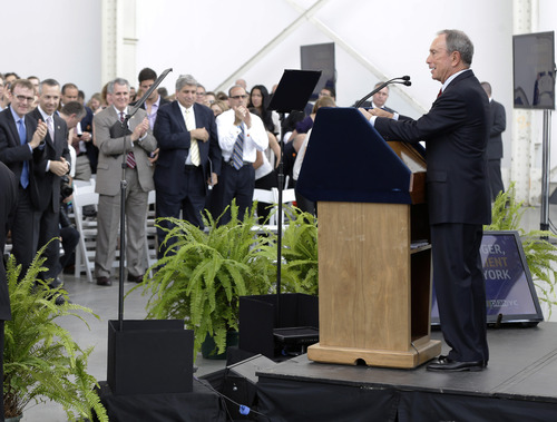 """New York City Mayor Michael Bloomberg speaks about the the city's long-term plans for dealing with climate change at the Brooklyn Navy Yards in New York, Tuesday, June 11, 2013.  """"This plan is incredibly ambitious,"""" Bloomberg said in the speech, acknowledging that much of the work would extend beyond the end of his term this year. (AP Photo/Seth Wenig)"""