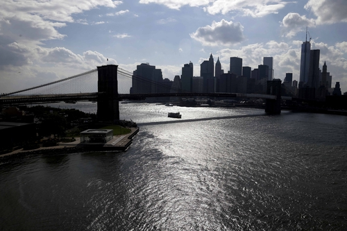 The skyline of lower Manhattan in seen past the East River in New York, Tuesday, June 11, 2013. The projections paint an unsettling picture of New York's future: a city where by the 2050s, 800,000 people could be living in a flood zone that would cover a quarter of the land, and there could be as many 90-degree days as is now normal for Birmingham, Ala. Facing those new projections of the effects of global warming on the nation's biggest city, Mayor Michael Bloomberg talked Tuesday about what to do about risks that Superstorm Sandy brought into stark relief. (AP Photo/Seth Wenig)