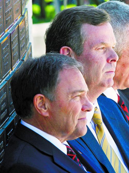 Al Hartmann  |  The Salt Lake Tribune Utah Governor Gary Herbert, left,  and Utah Attorney General John Swallow were in attendance in ceremony honoring fallen officers at a memorial at the Utah State Capitol Thursday May 2.