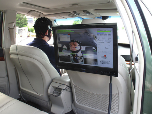Isobel Markham  |  The Salt Lake Tribune AAA representative Russ Martin demonstrates the instrumented vehicle fitted with technology to measure levels of cognitive distraction.