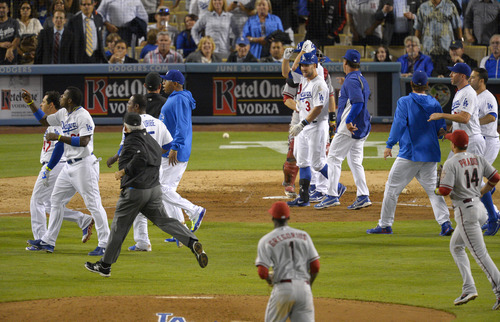 Members of the Los Angeles Dodgers and the Arizona Diamondbacks run on to the field during a scuffle in the seventh inning of their baseball game, Tuesday, June 11, 2013, in Los Angeles.  (AP Photo/Mark J. Terrill)