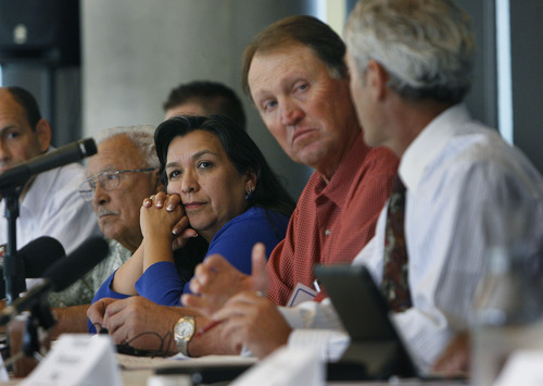 Scott Sommerdorf   |  The Salt Lake Tribune Rep. Rebecca Chavez-Houck, D-Salt Lake, center, listens as Summit County Councilman David Ure, left, speaks with Salt Lake City Mayor Ralph Becker after a roundtable discussion on immigration, along with business leaders as Congress begins debate on comprehensive immigration reform bill, Wednesday, June 12, 2013.
