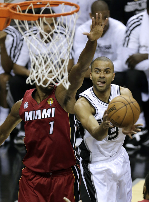 San Antonio Spurs' Tony Parker (9) shoots against Miami Heat's Chris Bosh (1) during the first half of Game 3 in their NBA Finals basketball series, Tuesday, June 11, 2013, in San Antonio. (AP Photo/David J. Phillip)