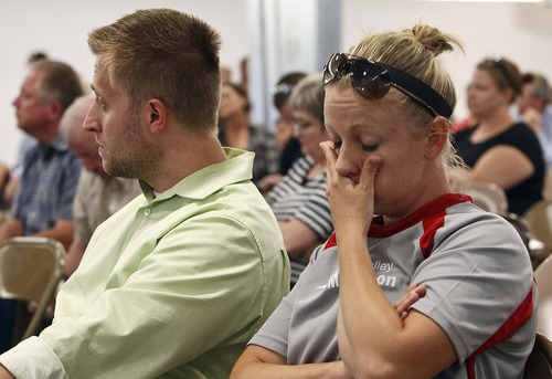 Leah Hogsten  |  The Salt Lake Tribune Lisa Barkdull of Farmington rubs her face in exasperation while listening to pro-freeway supporters. Environmental and community groups opposed to the West Davis Corridor had their say outside the Legacy Events Center as UDOT held its first public hearing on the proposed freeway,  June 11, 2013.
